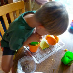 Montessori Summer Practical Life Activities ~ Corn and Orange Juice