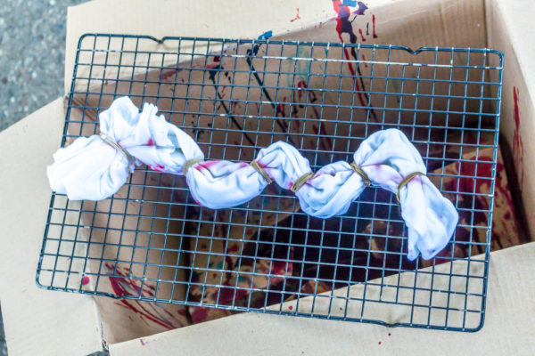 typing knots in tie-dye t-shirt